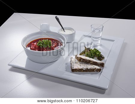 Ukrainian red borscht with salo sandwiches on ceramic tray