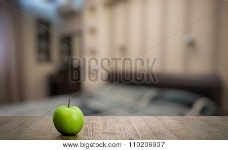 green apple old wooden table in the bedroom