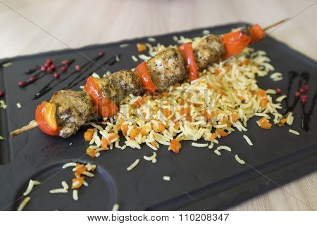 Chicken shish kebab and rice with vegetables