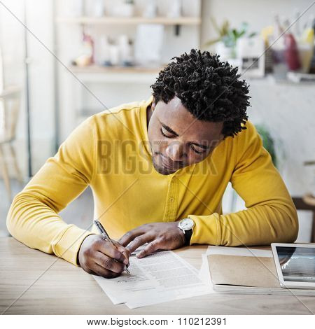 African Man Planning Stock Exchange Writing Concept