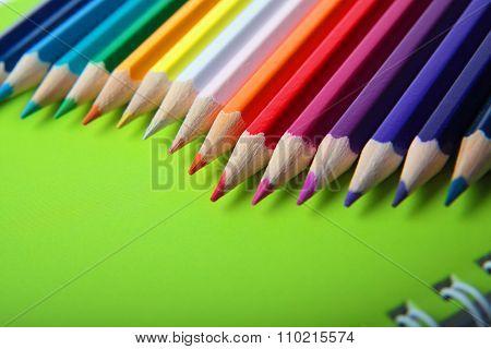 Bright Multicolor Pencils On Note Book