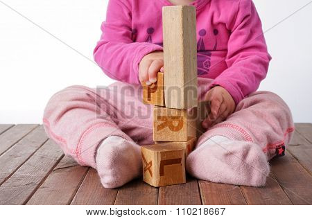 Toddler Girl Playing With Wooden Blocks