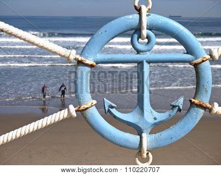 Blue Anchor Sign On The Beach Parapet