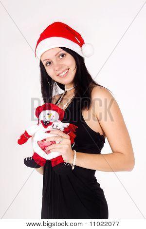 Santa Girl  Holding A Snowman