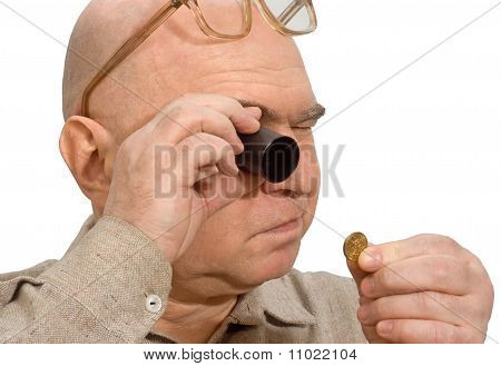 Jeweler Magnifier Hands Of A Numismatist Coin