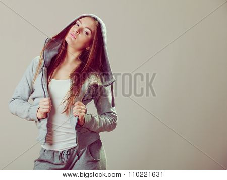 Pensive Teenage Girl In Hooded Sweatshirt. Fashion