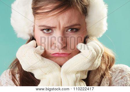 Unhappy Funny Cute Pretty Woman Girl In Earmuffs.