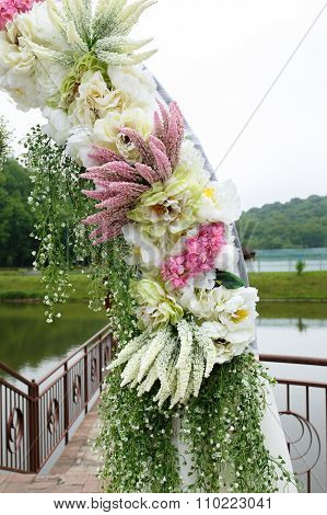 Unique Floral Wedding Archway Covered With Flowers, Plants And Bouquets Close-up