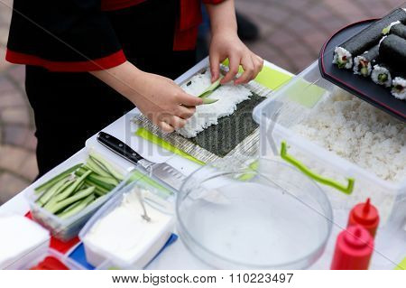 Master Chef Preparing Delicious Wedding Sushi Outdoors With A Variety Of Ingredients