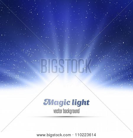 Blue holiday burst abstract magic light background.
