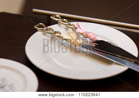 Wedding Table Silverware Heart Shaped Knifes With Ribbons Close-up