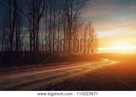 Sunset and car light trails