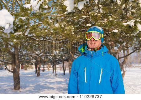 Portrait Of Sporty Man Who Is Wearing Winter Jacket And Ski Goggles
