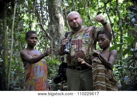 Central African Republic - November 2, 2008: The White Person The Tourist And Women From A Tribe Of