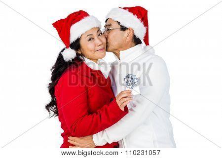Festive senior couple exchanging gifts on white background