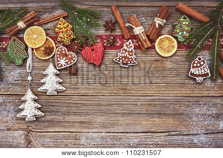 Christmas Wooden Background With Christmas Cookies, Cinnamon And Christmas Tree. Toned