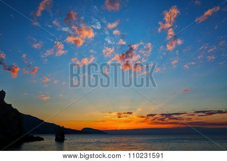 Beautiful Bright Sunrise Over The Sea And Cliffs