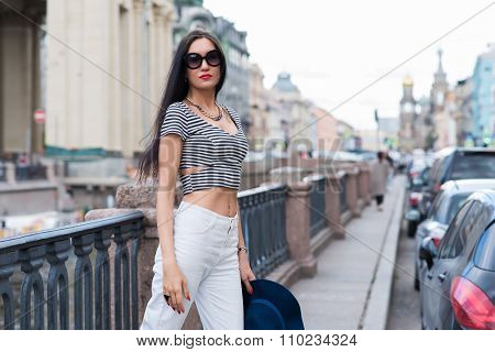 Half length portrait of an attractive female tourist on the background of wonderful building
