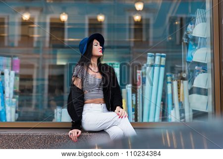 Elegant woman is chilling after walk in the city center and enjoying her vacations weekends
