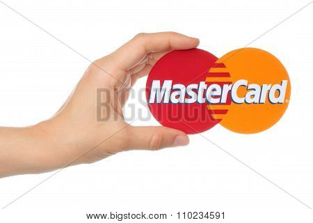 Hand holds Mastercard logo