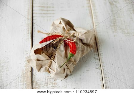 Parcel Package Wrapped With Brown Kraft Paper Tied Rope  On Wooden Boards