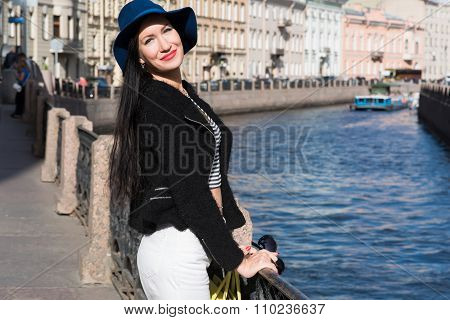 Beautiful and gorgeous female posing in urban setting with copy space background