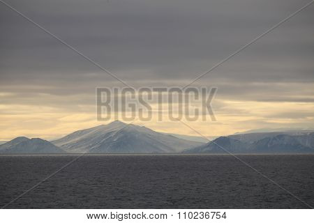 Picturesque Graphic Scenic View Of Shore Line With Snow-covered Hills