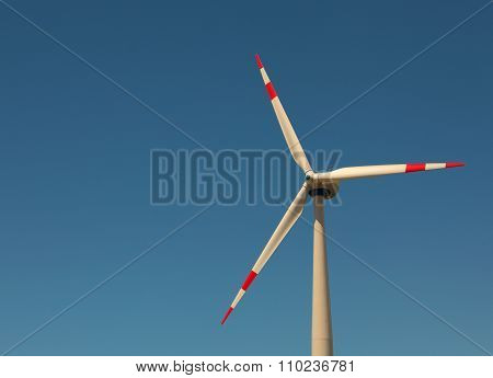 Windmill Against Bright Blue Sky