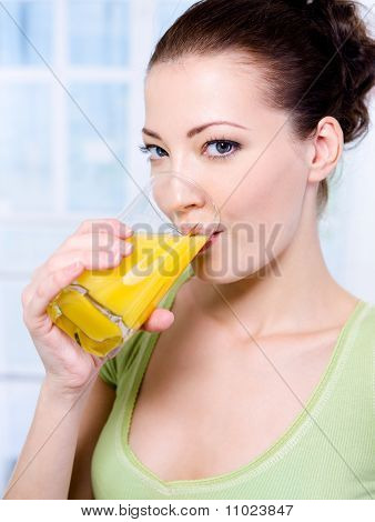 Caucasian Woman With A Glass Of Orange Juice