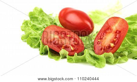 Red tomato on lettuce isolated