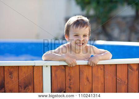 Cute Kid In A Big Swimming Pool