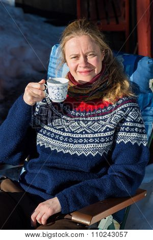 Close Up Of Young Pretty Norwegian Woman Enjoying Some Winter Sunshine And A Cup Of Coffee