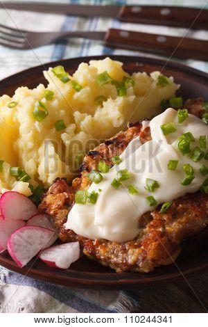 Fried Chicken Steak With Potato Garnish Close-up Vertical