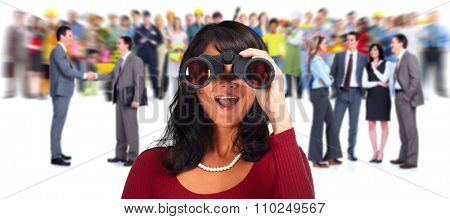 Business woman with binoculars over people group background.