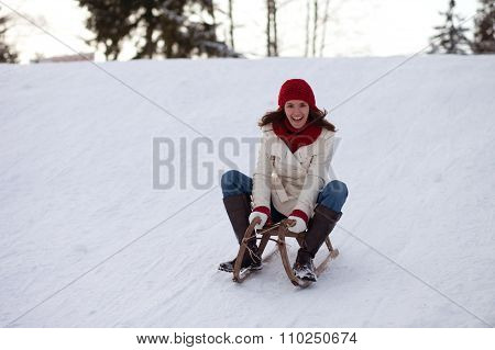Girl, Sitting On A Sledge, Going Down On The Hill