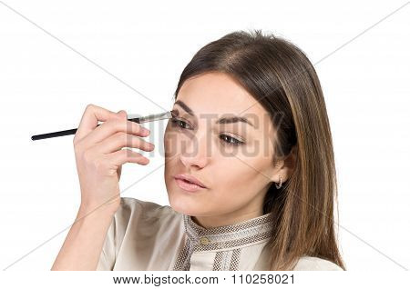 Visagiste. Young Girl Paints Her Eyes. Girl Doing Makeup