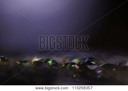 Abstract blurred rainbow water drops close up