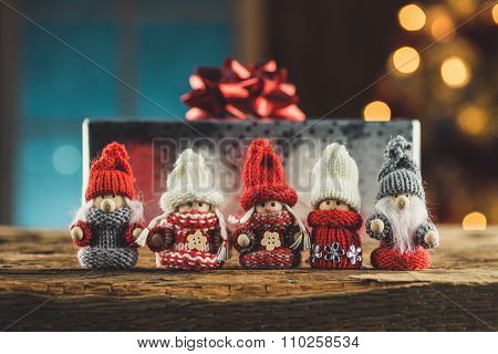 Gnomes Family On Wooden Table In Cosy Cottage