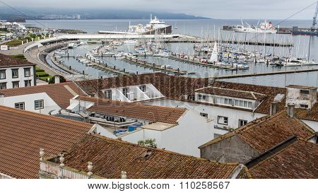 PONTA DELGADA, PORTUGAL - JUN 15, 2015: Top view of the Sea Port of Ponta Delgada (Azores). City is located on Sao Miguel Island (232.99 km2) Region capital under the revised constitution of 1976.