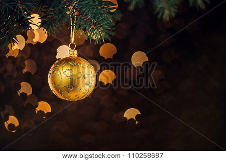 Christmas Ball Hanging On Spruce Twig, Bokeh Background