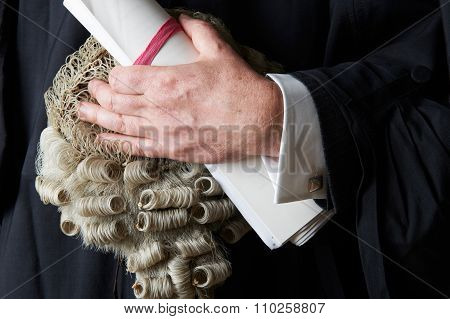 Close Up Of Barrister Holding Wig And Brief