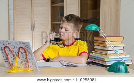 Boy With Funny Glasses Doing Homework. Child With Learning Difficulties. Boy Having Problems With Hi