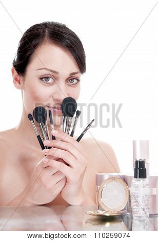 Young Woman With Makeup Brushes Near The Face, Isolated On White Background.