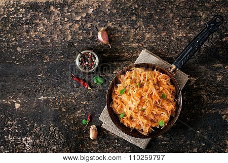 Stewed Cabbage On The Old Wooden Background In Rustic Style. Top View