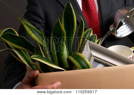 Redundant Businessman With Possessions In Box