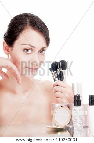 Pretty Woman With Makeup Brushes Near The Face, Isolated On White Background.