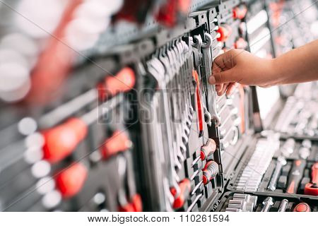 Worker At The Store Chooses Wrench Tools