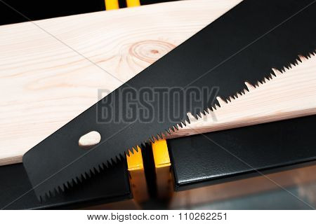 Hand Saw On The Wooden Workshop Background