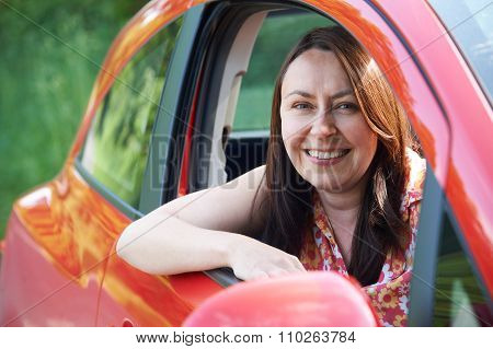 Portrait Of Mature Female Driver In Car