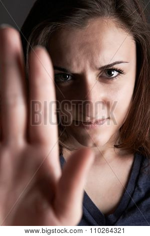 Frightened Teenage Girl Making Stop Gesture